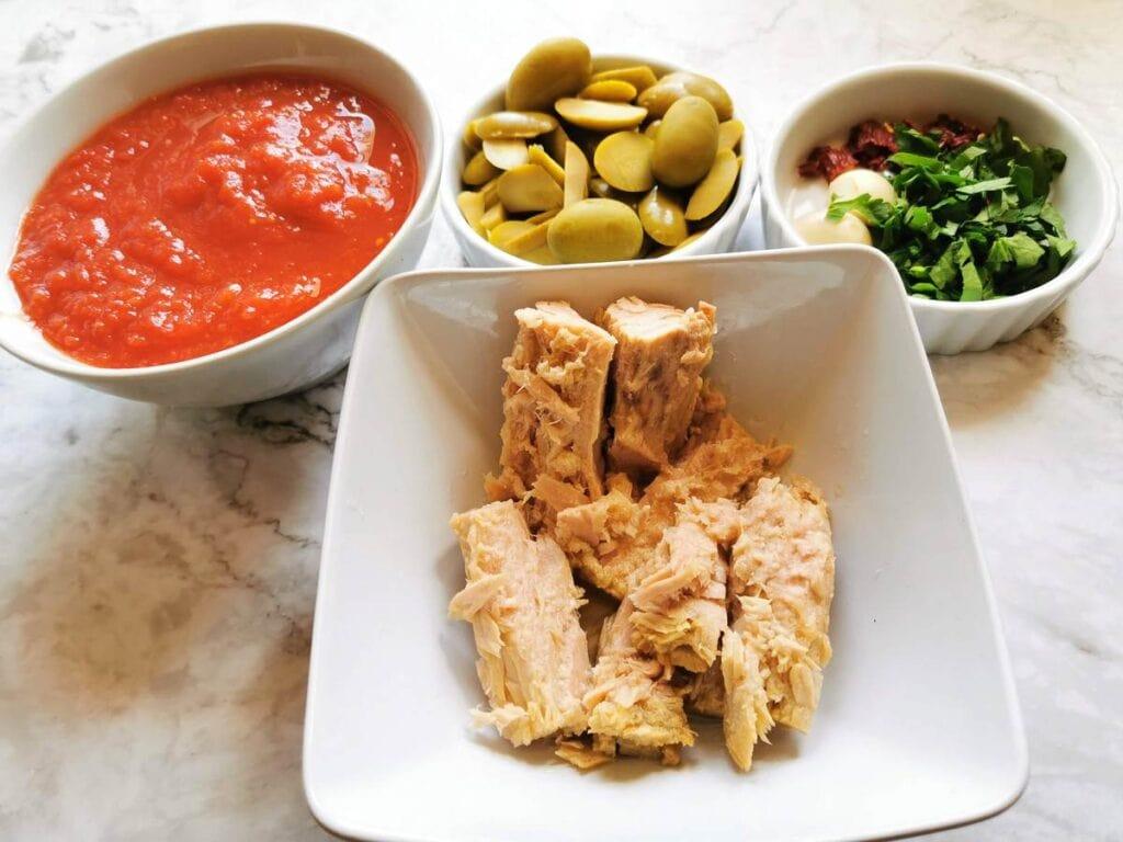drained tuna,, chopped parsley, peeled garlic, chopped peperoncino, passata and chopeed olives in white bowls