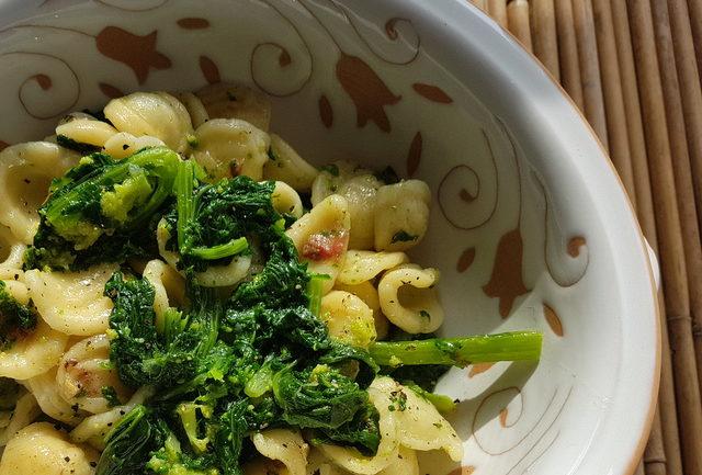 Close up orecchiette with Broccoli Rabe (rapini) in white terracotta bowl