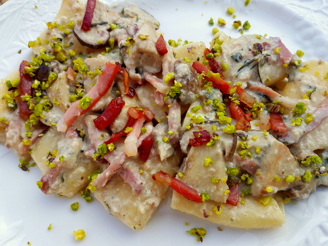 Paccheri with porcini, pistachios and speck.