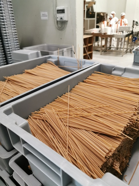 whole wheat pasta cut and ready to be packaged