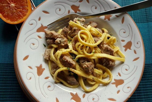 Fettuccine Pasta Ossobuco in white terracotta bowl