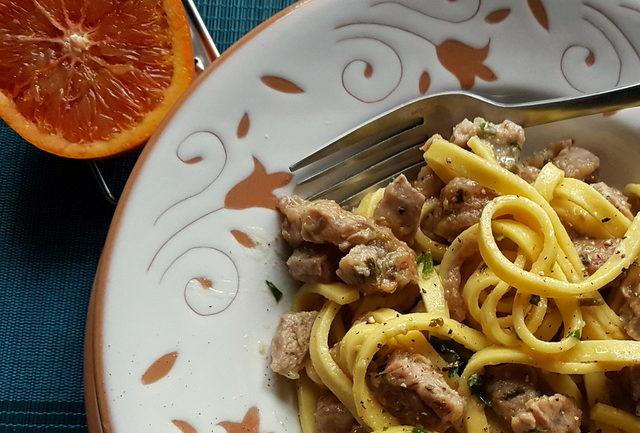 Fettuccine Pasta Ossobuco close up in white and terracotta bowl