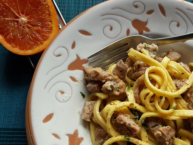 Pasta Ossobuco close up in white and terracotta bowl