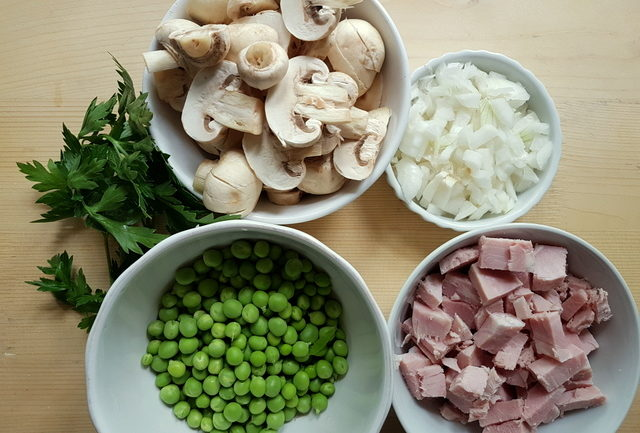 shelled peas, sliced mushrooms,chopped onion and cooked ham pieces in bowls