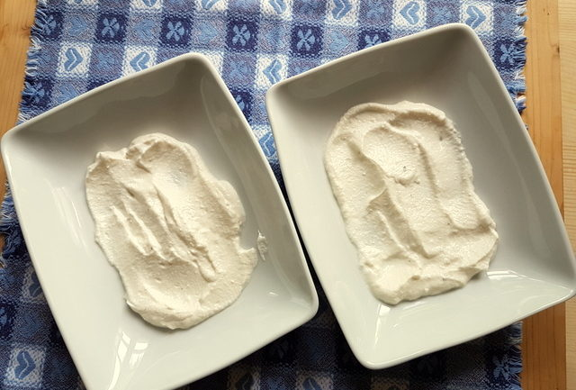 creamed ricotta in two white bowls