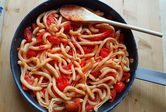 spaccatelle pasta with homemade tomato sauce in frying pan