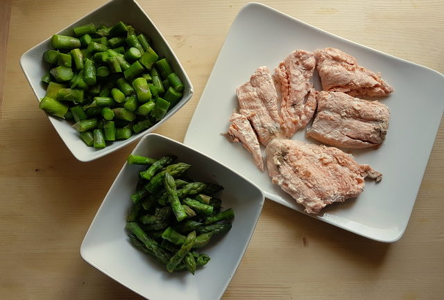 chopped boiled asparagus and poached salmon on white plates ingredients for poached salmon and asparagus lasagne al forno