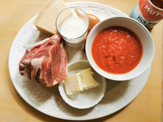 ingredients for prosciutto ragu on white plate