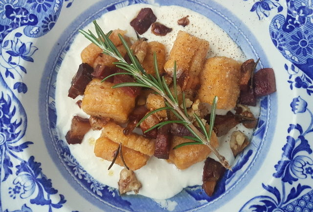 Homemade pumpkin gnocchi with speck and walnuts