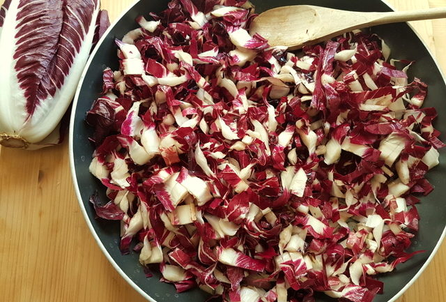 chopped radicchio cooking in frying pan