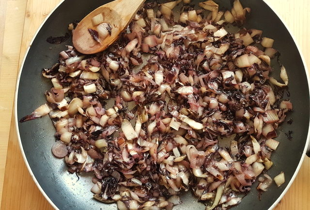 radicchio and shallots cooking in frying pan
