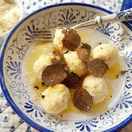 Ricotta gnudi with black truffle