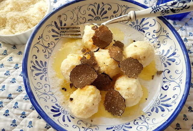 Ricotta gnudi with black truffle
