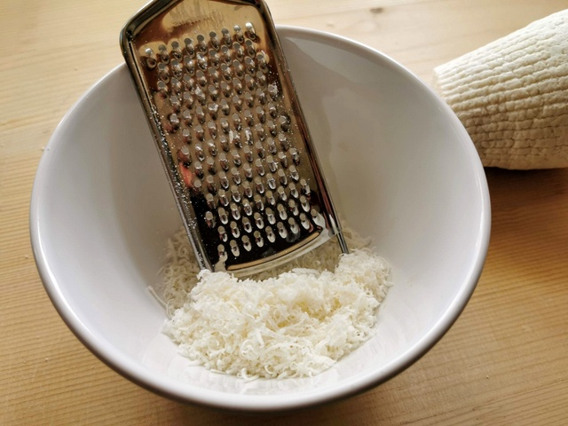 grated ricotta Marzotica in white bowl