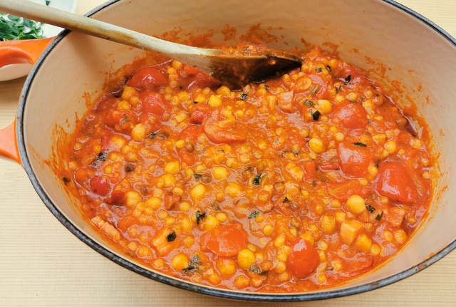 Sardinian fregola with chickpeas ready to serve in Dutch oven