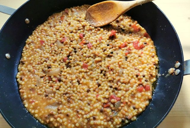 cooked fregola in skillet