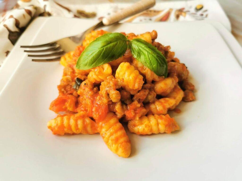 Malloreddus alla Campidanese with sausage, saffron and tomatoes.