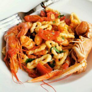 Sardinian lorighittas pasta with prawns and scampi.