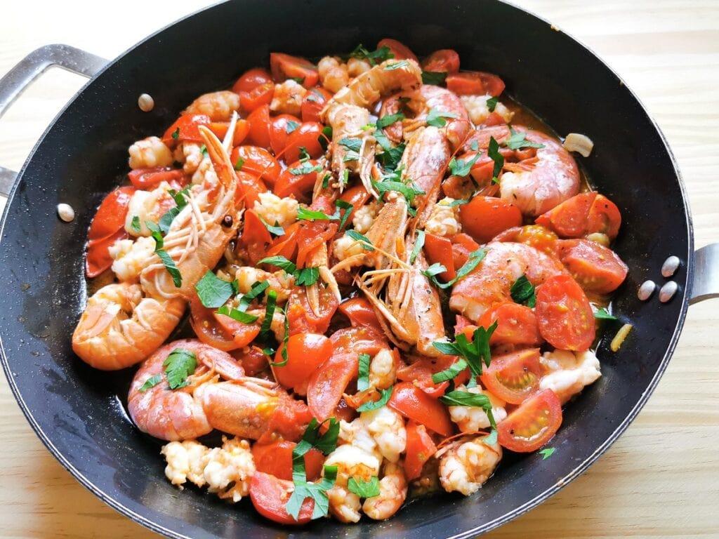 Sardinian lorighittas pasta with prawns and scampi. Seafood pasta recipe from Sardinia