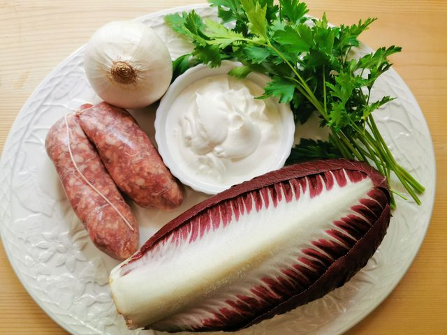 sausages and radicchio on white plate