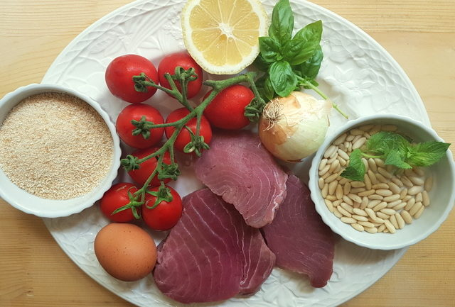 ingredients for Sicilian fresh tuna meatballs on white plate