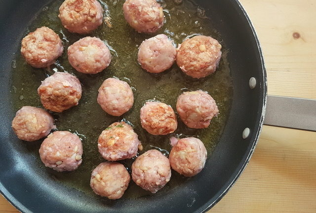 tuna meatballs cooking in frying pan