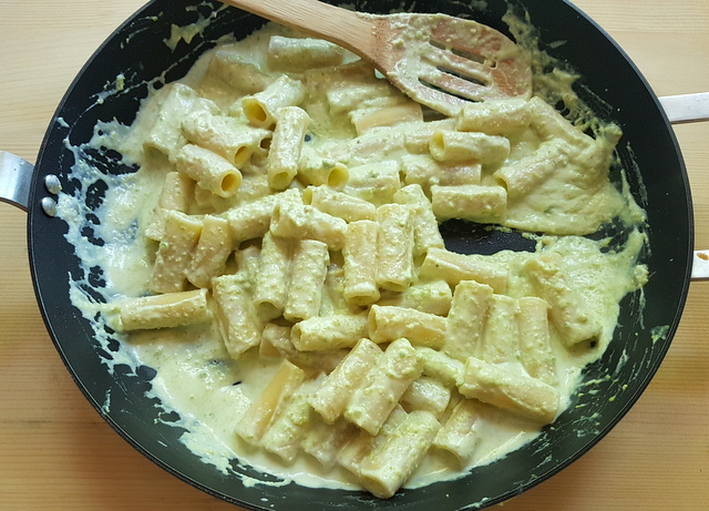 occhio di lupo pasta mixed with ricotta pistachio sauce in frying pan