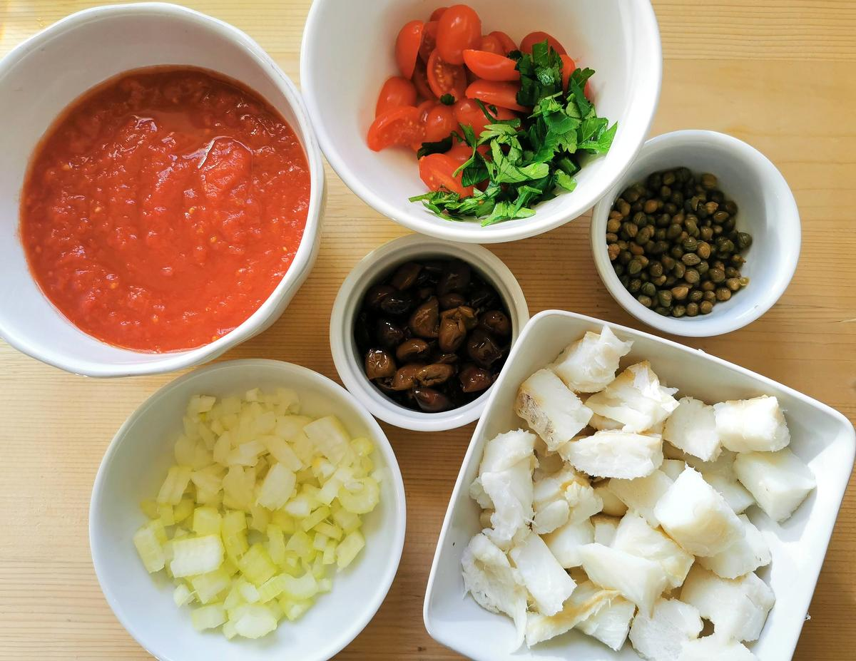 Prepared ingredients for spaghetti with salt cod