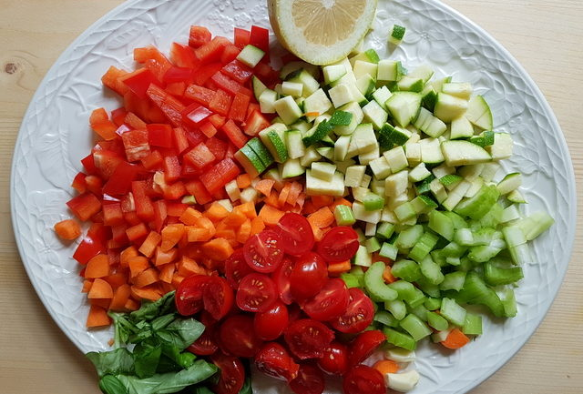 chopped vegetables on white plate for summer tagliolini pasta with marinated vegetables
