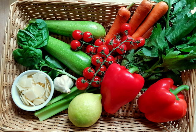 Ingredients in basket for summer tagliolini pasta with marinated vegetables