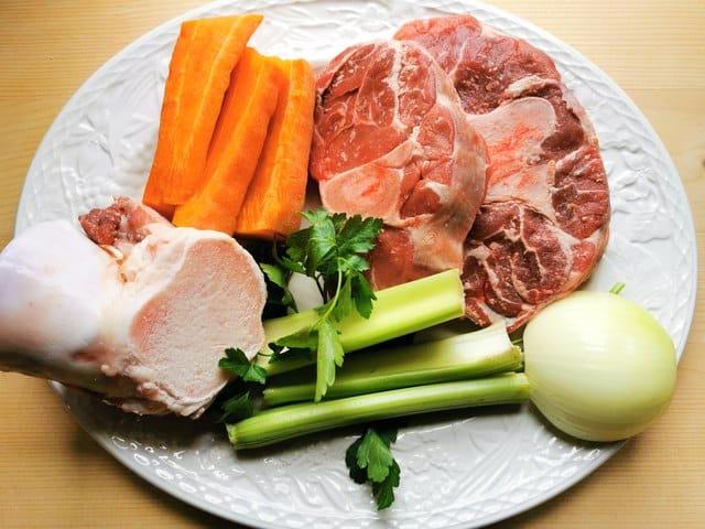 beef broth ingredients on white plate