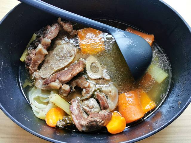 cooked beef broth in Dutch oven before filtering