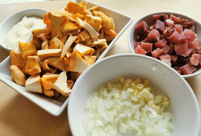 chopped onions and garlic with diced speck and chopped chanterelle mushrooms