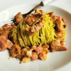 tagliolini pasta with chanterelle mushrooms and speck