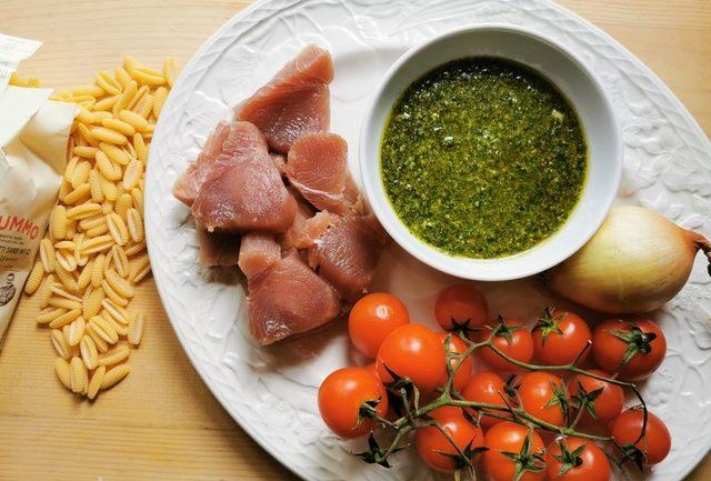 ingredients for malloreddus alla carlofortina on white plate