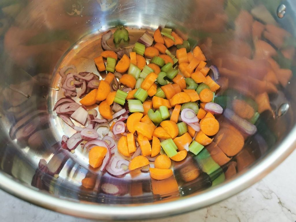 a 'soffritto' of carrots, onions and celery in deep pan.