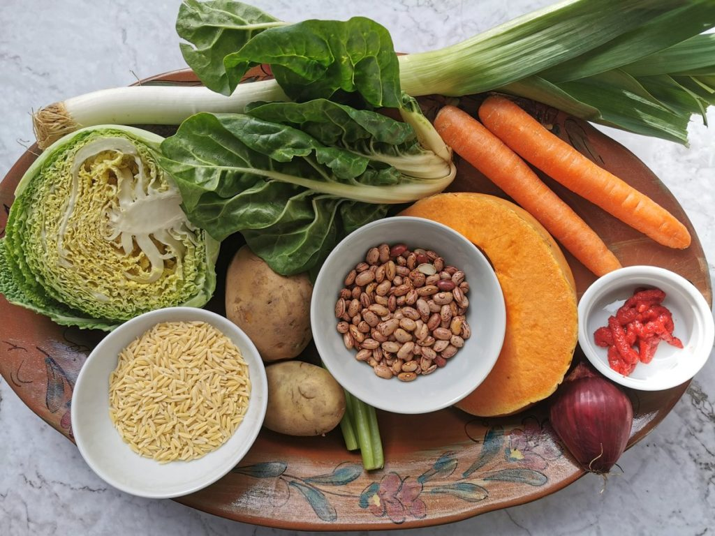 Ingredients for this Tuscan minestrone on an oval terracotta plate