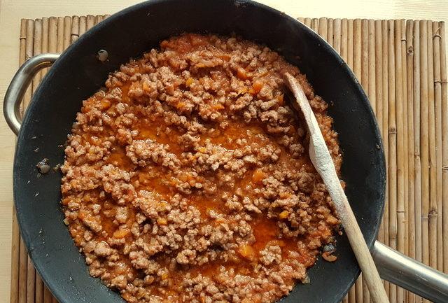 meat ragu in frying pan