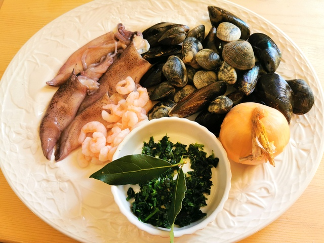 ingredients for the seafood sauce on a white plate