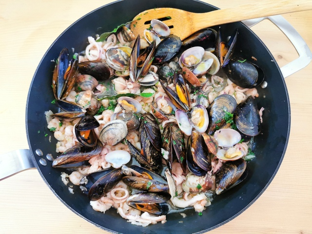 ready seafood sauce in skillet