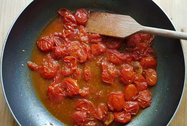 roasted cherry tomato pasta sauce in frying pan