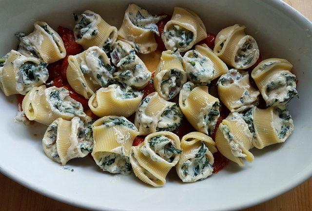 baked lumaconi pasta shells with chicory and porcini