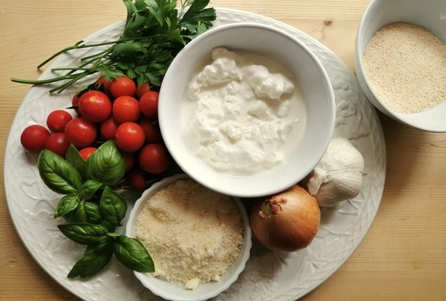 ingredients for pasta alla Tranese on white plate