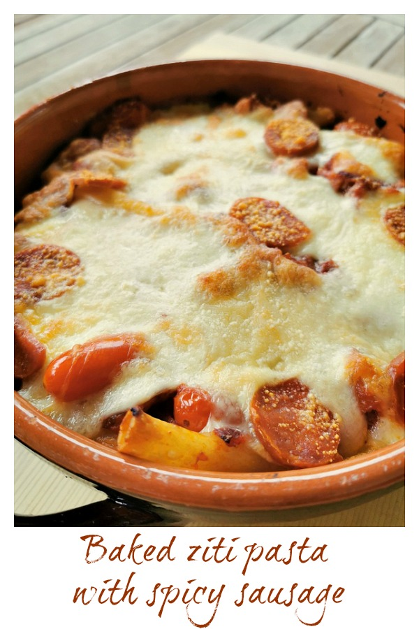 baked ziti with spicy sausage in terracotta oven dish
