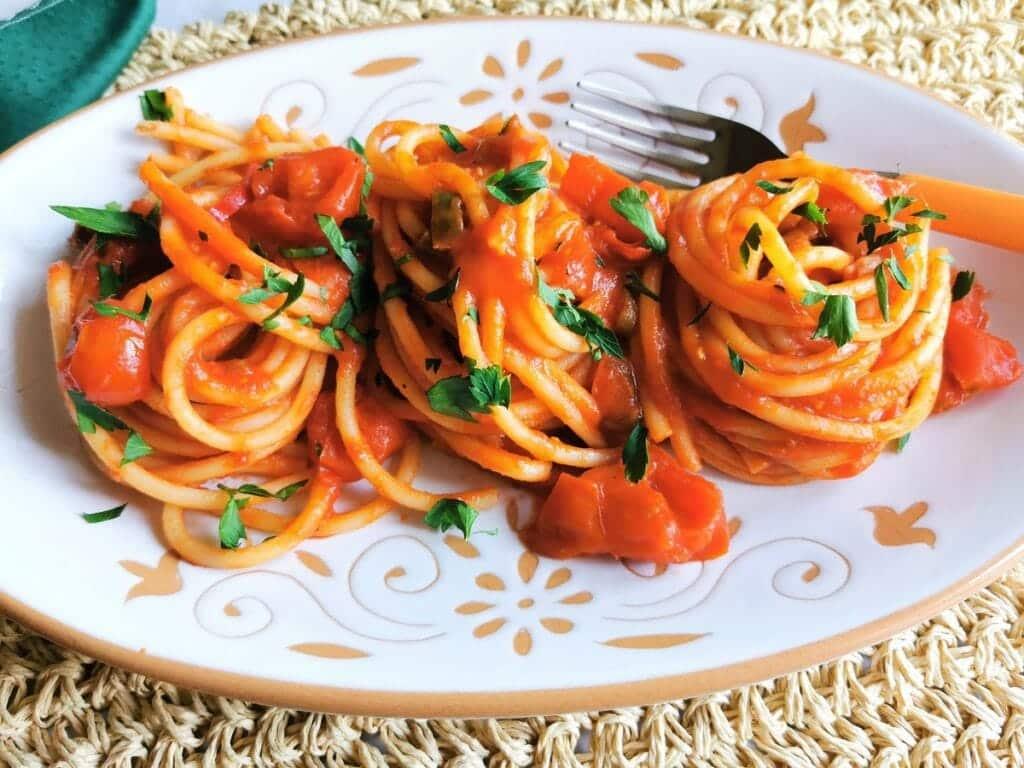 Bucatini all'arrabbiata from Rome. A vegetarian summer pasta recipe.