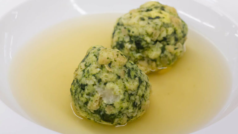 canederli made with spinach in clear broth