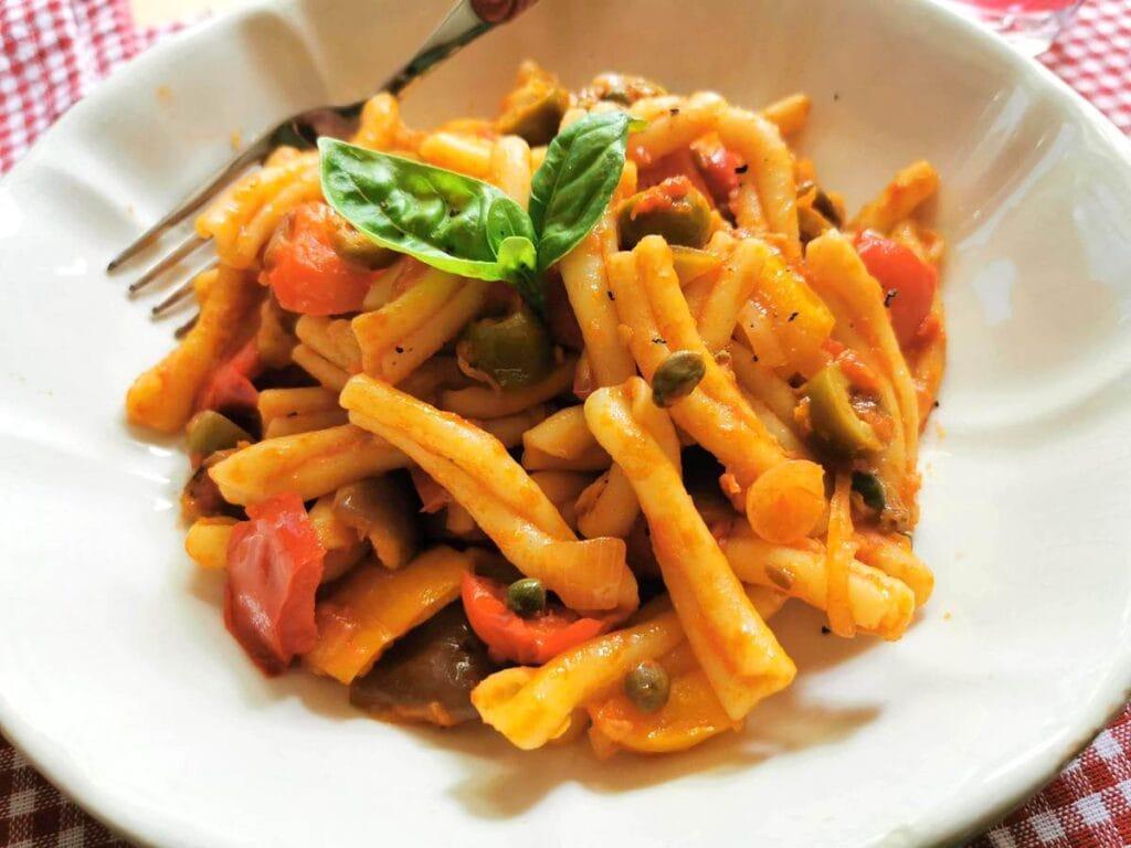 Casarecce with caponata an Italian summer pasta recipe from Sicily.