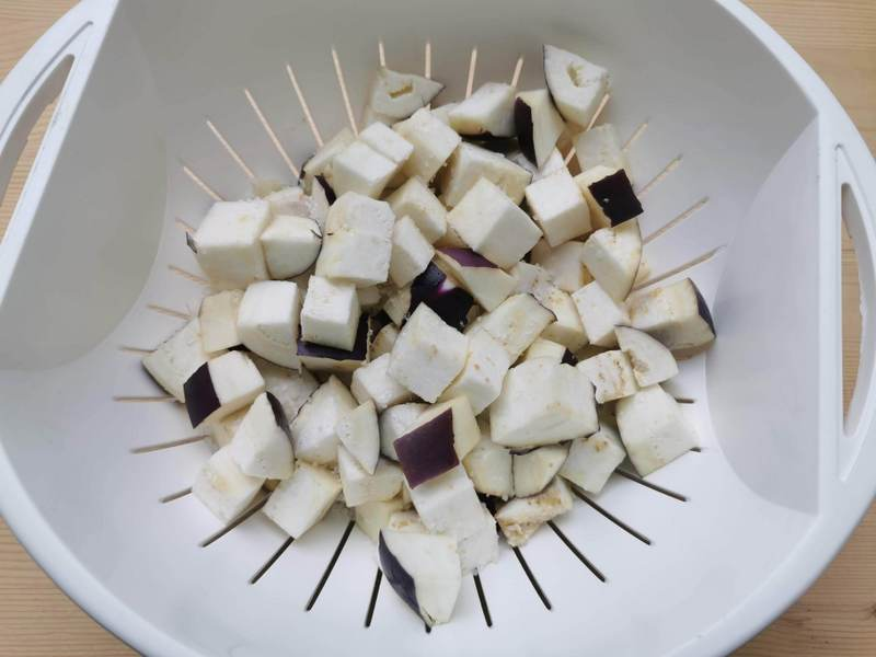 cubed eggplant in colander