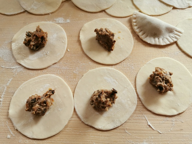 fresh pasta dough discs with prune and fig filling in the centre