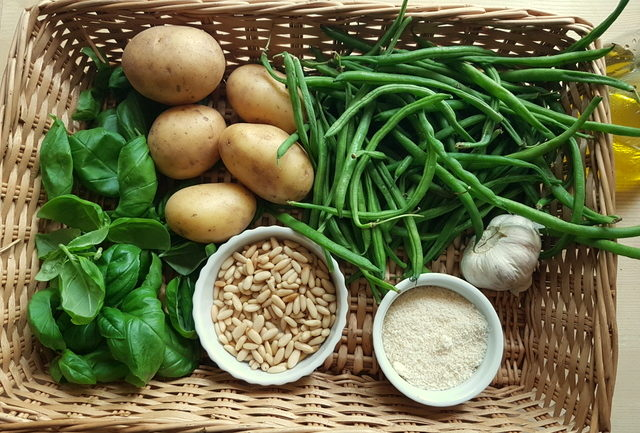 Ingredients in basket for pesto pasta Liguria with potatoes and green beans